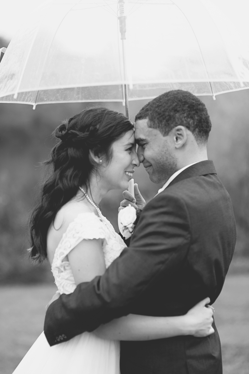 Hampton, Virginia Fall Wedding | Bride and groom rainy day umbrella portraits