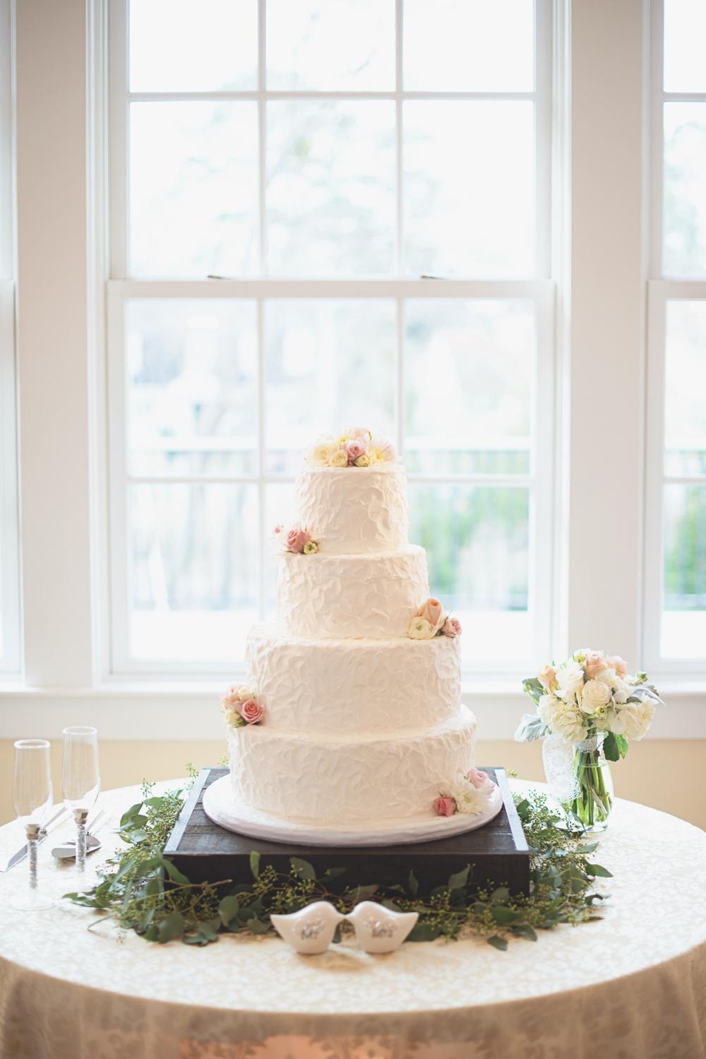 Blush, mint, and ivory spring wedding | Buttercream wedding cake