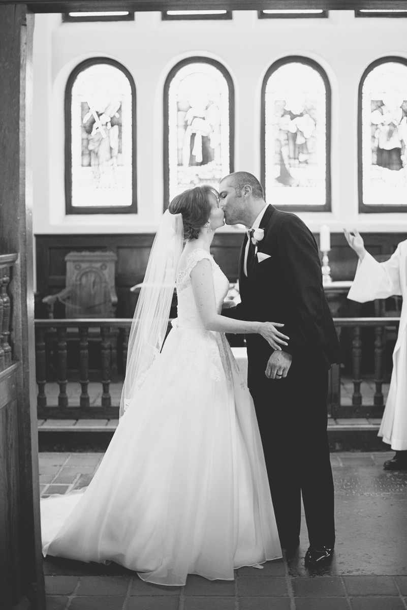 Blush and White Historic Church Wedding | Smithfield, Virginia | Wedding ceremony first kiss