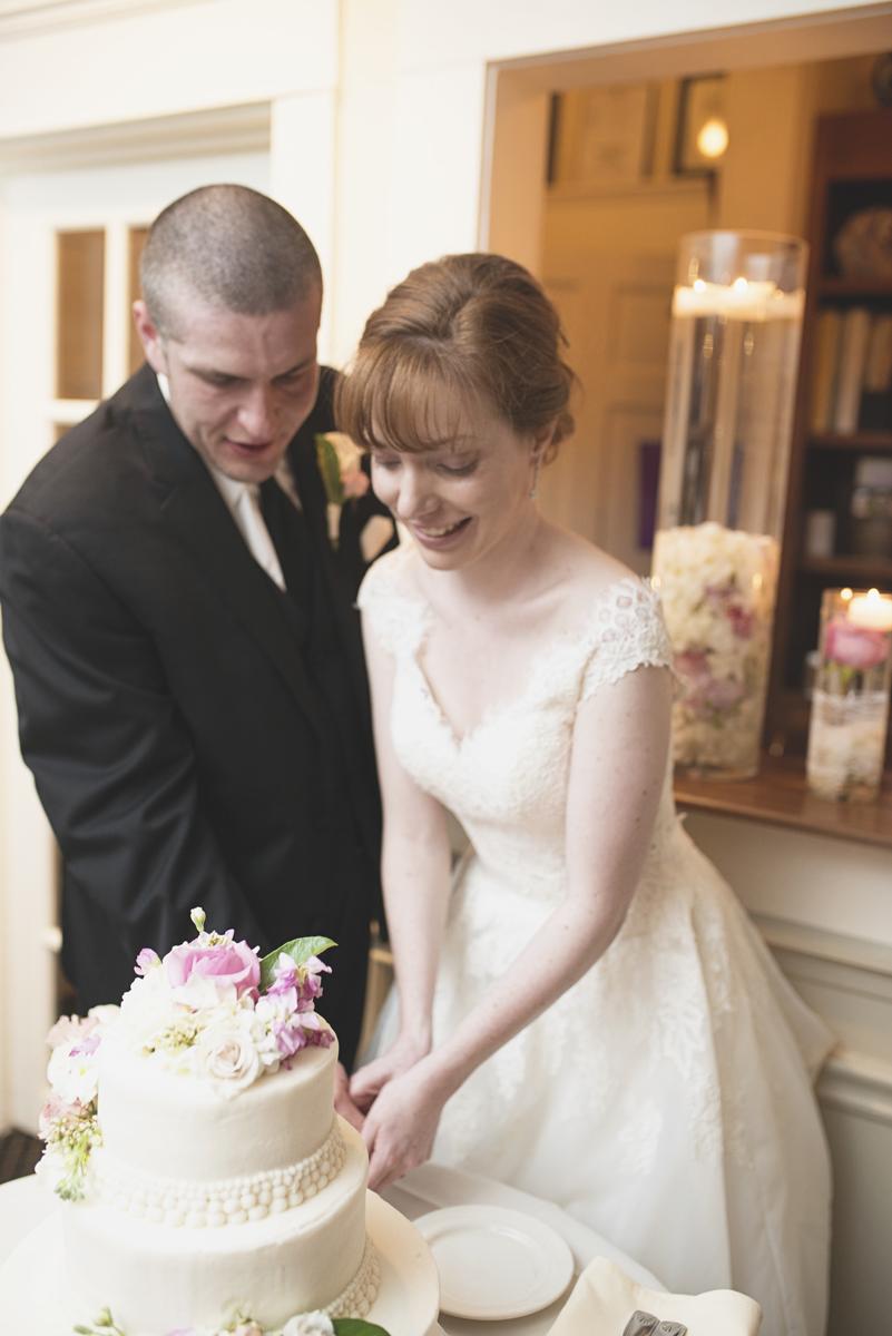 Blush and White Historic Church Wedding | Smithfield, Virginia | Wedding cake cutting