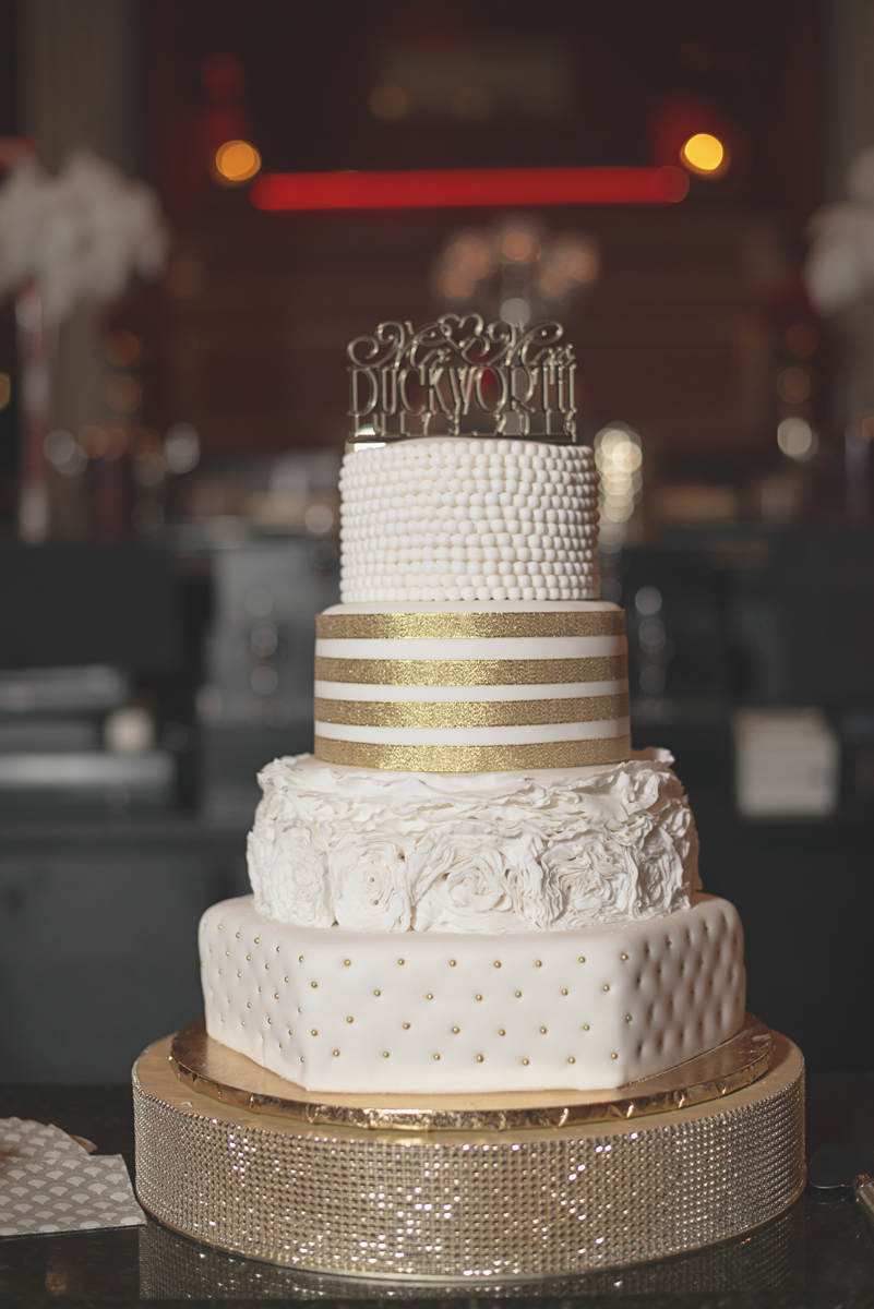 Great Gatsby Themed Urban Wedding | Ornate gold and white Great Gatbsy wedding cake