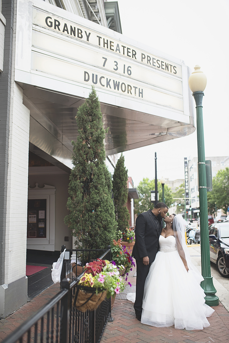 Great Gatsby Themed Urban Wedding | Bride and groom portraits in front of theater marquee
