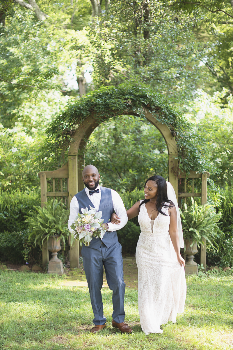Elegant Lavender Plantation Elopement | Bride and groom walking portraits