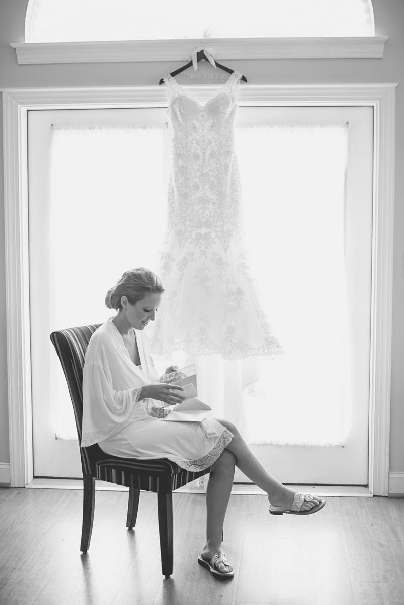 Nautical Navy Virginia Wedding | Navy Blue Wedding Colors | Bride in front of her wedding dress