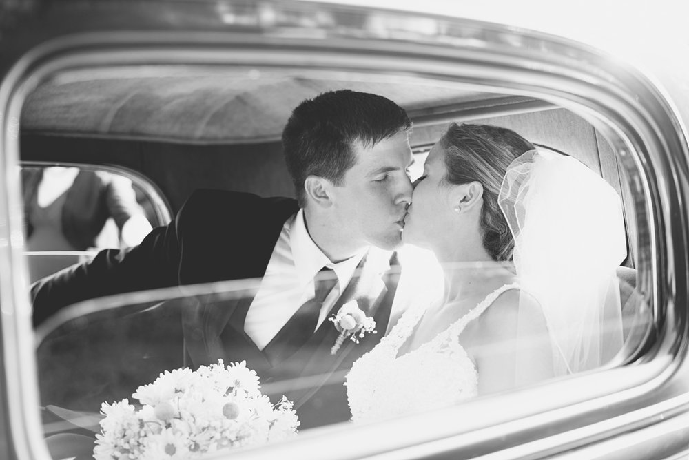 Nautical Navy Virginia Wedding | Navy Blue Wedding Colors | Bride and groom portraits in vintage car