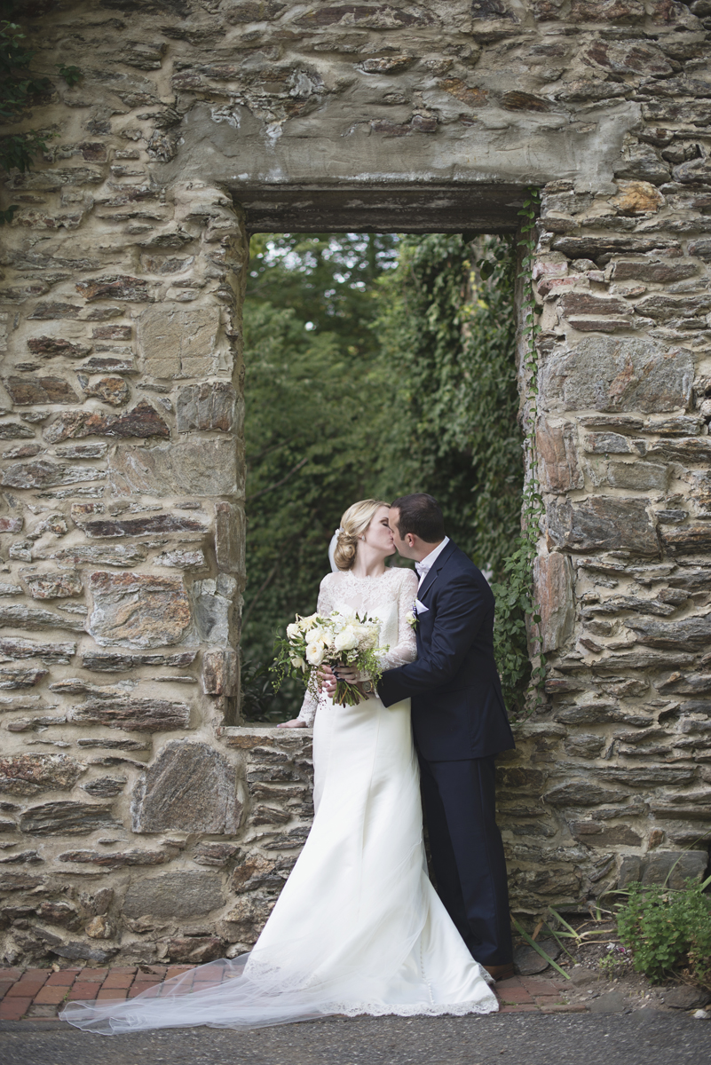 Elegant Gray, Navy, and White Wedding | The Old Mill at Rose Valley Pennsylvania Wedding | Bride and groom portraits by a stone wall
