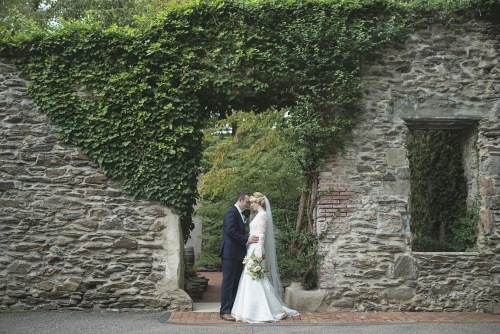 Elegant Gray, Navy, and White Wedding | The Old Mill at Rose Valley Pennsylvania Wedding | Bride and groom portraits in front of a stone wall