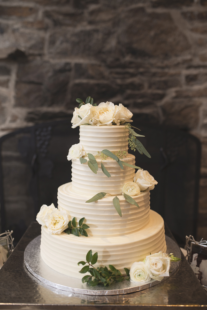 Elegant Gray, Navy, and White Wedding | The Old Mill at Rose Valley Pennsylvania Wedding | Elegant all-white wedding cake with greenery