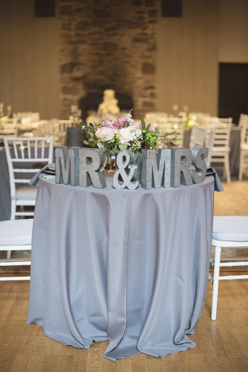 Elegant Gray, Navy, and White Wedding | The Old Mill at Rose Valley Pennsylvania Wedding | Elegant gray sweetheart table with Mr and Mrs signs
