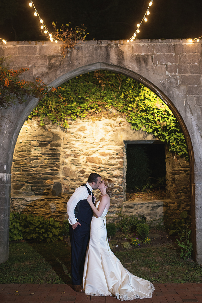 Elegant Gray, Navy, and White Wedding | The Old Mill at Rose Valley Pennsylvania Wedding | Bride and groom portrait under twinkling nighttime lights