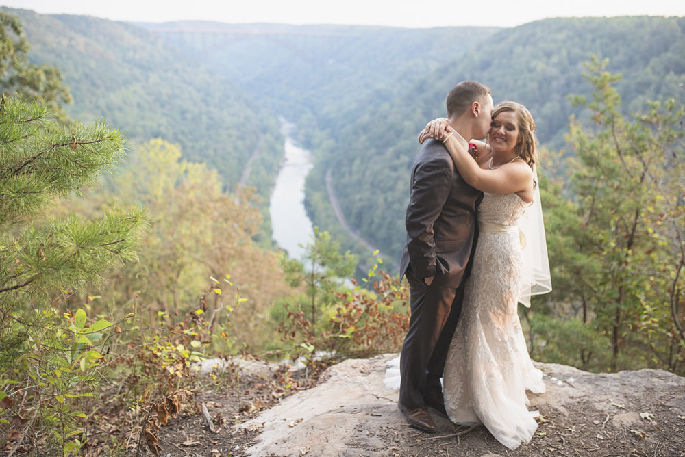 Adventures on the Gorge Destination Wedding | Maroon + Orange Wedding | Bride + groom portraits