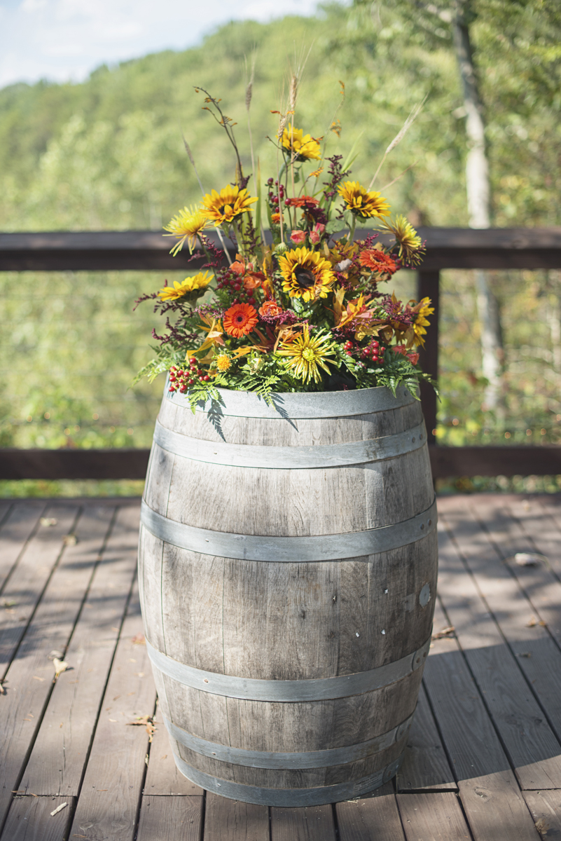 Adventures on the Gorge Destination Wedding | Maroon + Orange Wedding | Barrel ceremony decorations