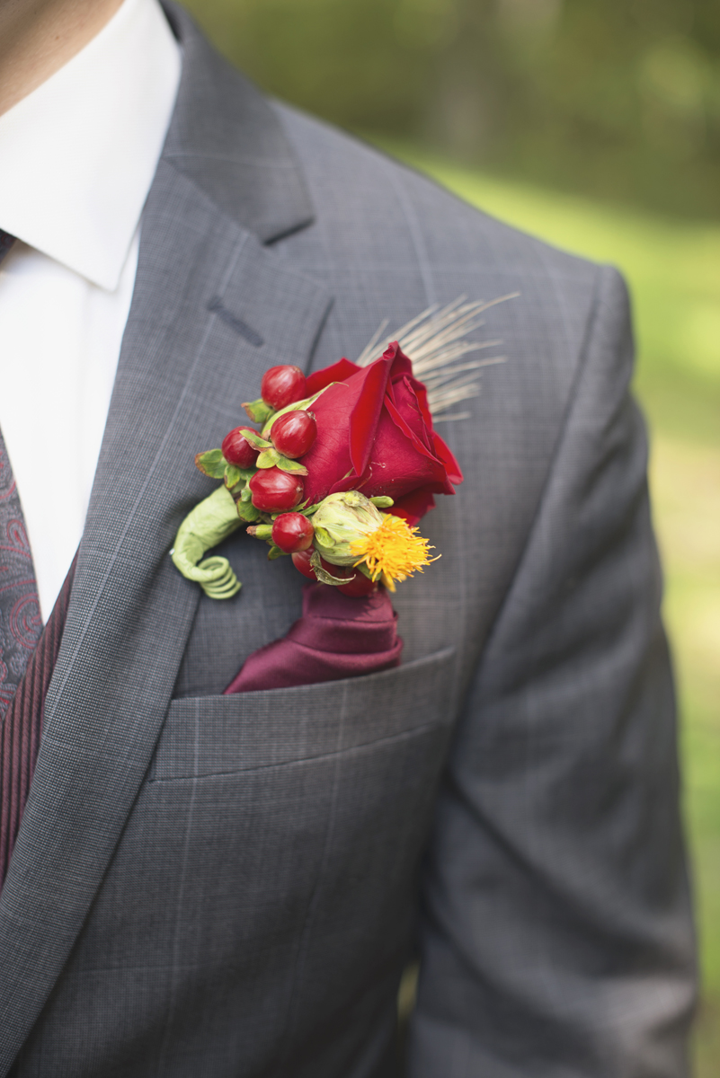 Adventures on the Gorge Destination Wedding | Maroon + Orange Wedding | Rustic red rose and berry boutonniere