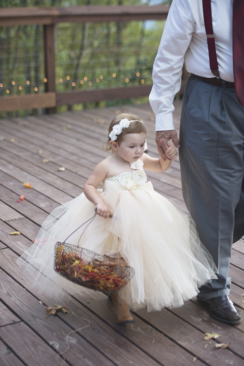Adventures on the Gorge Destination Wedding | Maroon + Orange Wedding | Flower girl with fall leaves and tulle skirt
