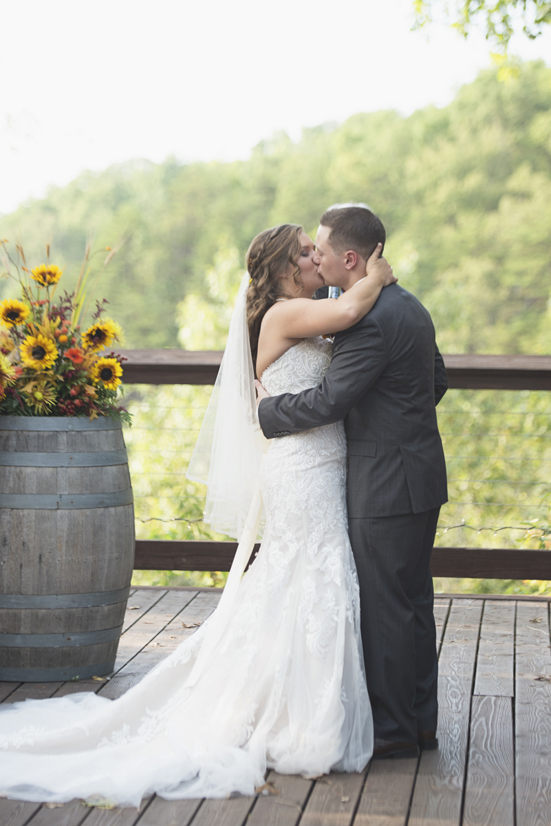 Adventures on the Gorge Destination Wedding | Maroon + Orange Wedding | Bride and groom first kiss