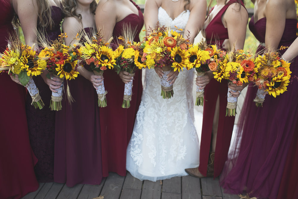 Adventures on the Gorge Destination Wedding | Maroon + Orange Wedding | Orange and yellow sunflower bouquets
