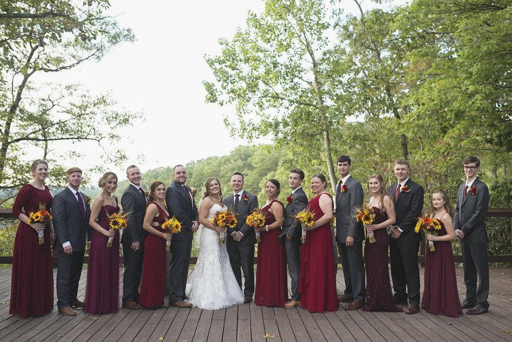 Adventures on the Gorge Destination Wedding | Maroon + Orange Wedding | Maroon and gray bridal party portraits