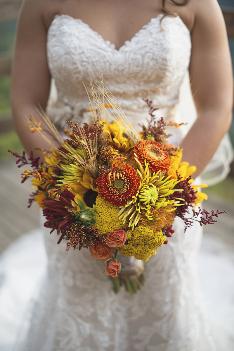 Adventures on the Gorge Destination Wedding | Maroon + Orange Wedding | Sunflower and orange bridal bouquet