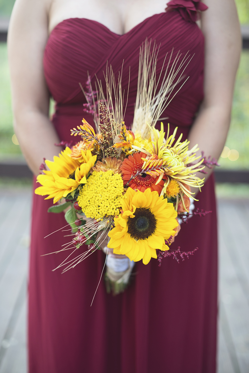 Adventures on the Gorge Destination Wedding | Maroon + Orange Wedding | Sunflower and orange bridesmaid bouquet