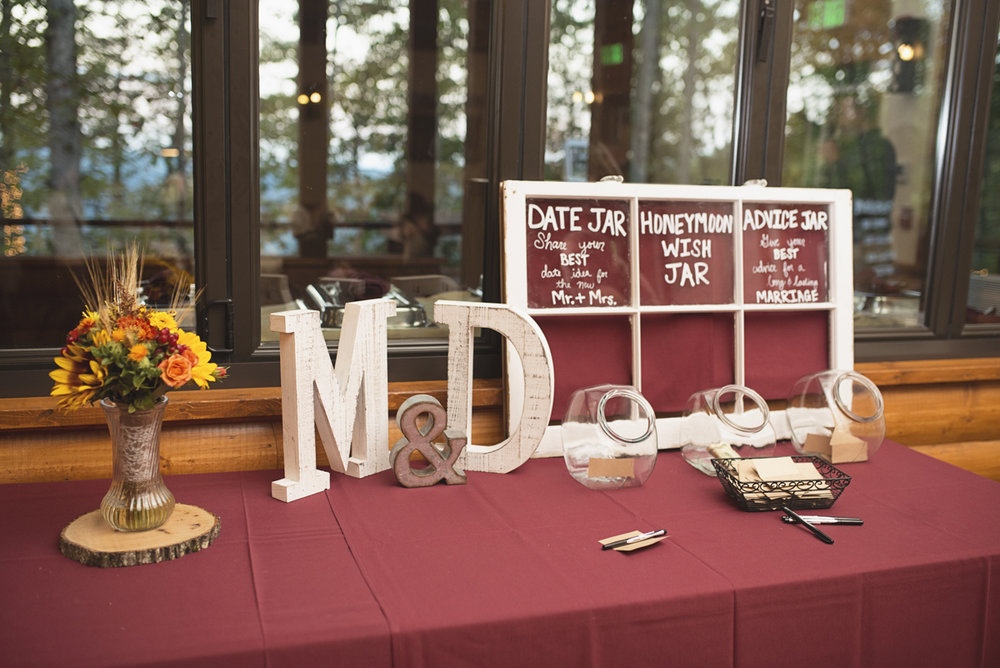 Adventures on the Gorge Destination Wedding | Maroon + Orange Wedding | Rustic wood reception decorations