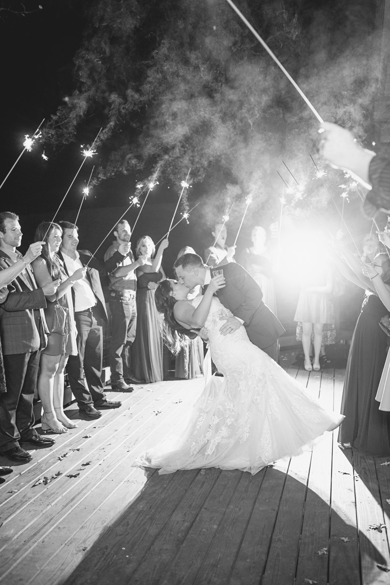 Adventures on the Gorge Destination Wedding | Maroon + Orange Wedding | Bride + groom sparkler exit