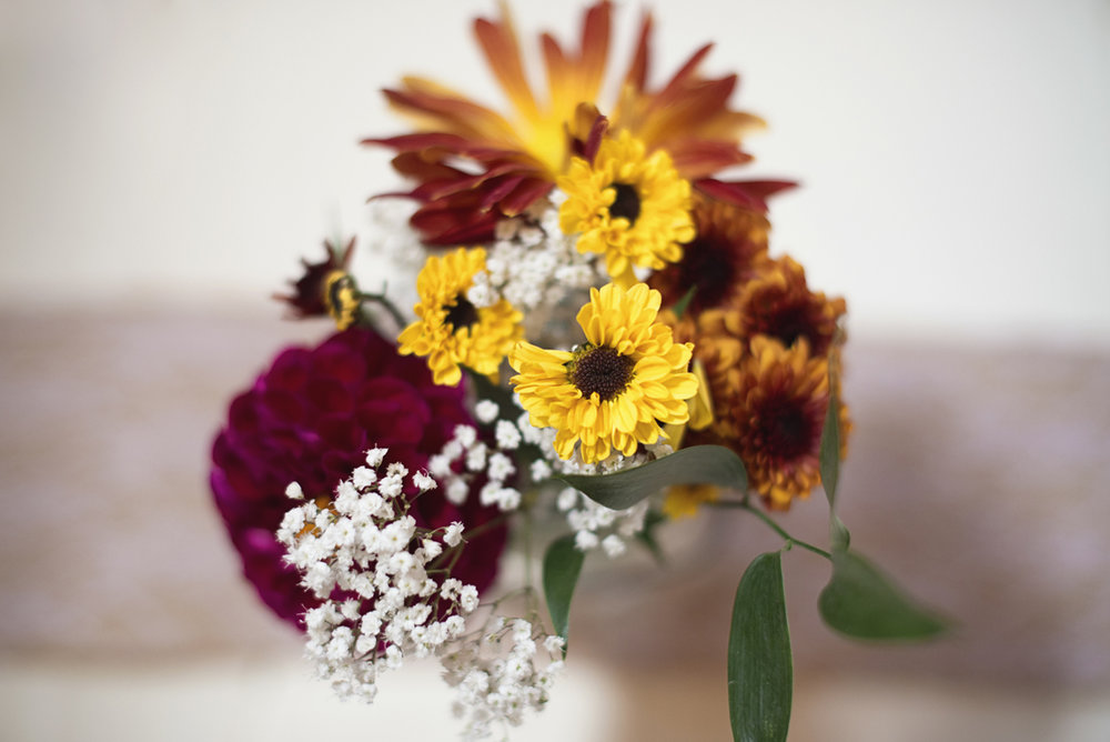 Orange and Maroon Virginia Tech Fall Wedding | Zion Springs Bed + Breakfast | Sunflower and dahlia reception centerpieces