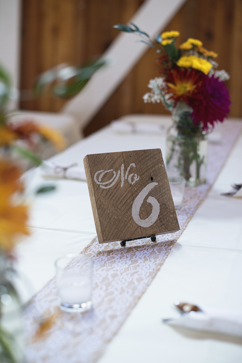 Orange and Maroon Virginia Tech Fall Wedding | Zion Springs Bed + Breakfast | Wooden table numbers