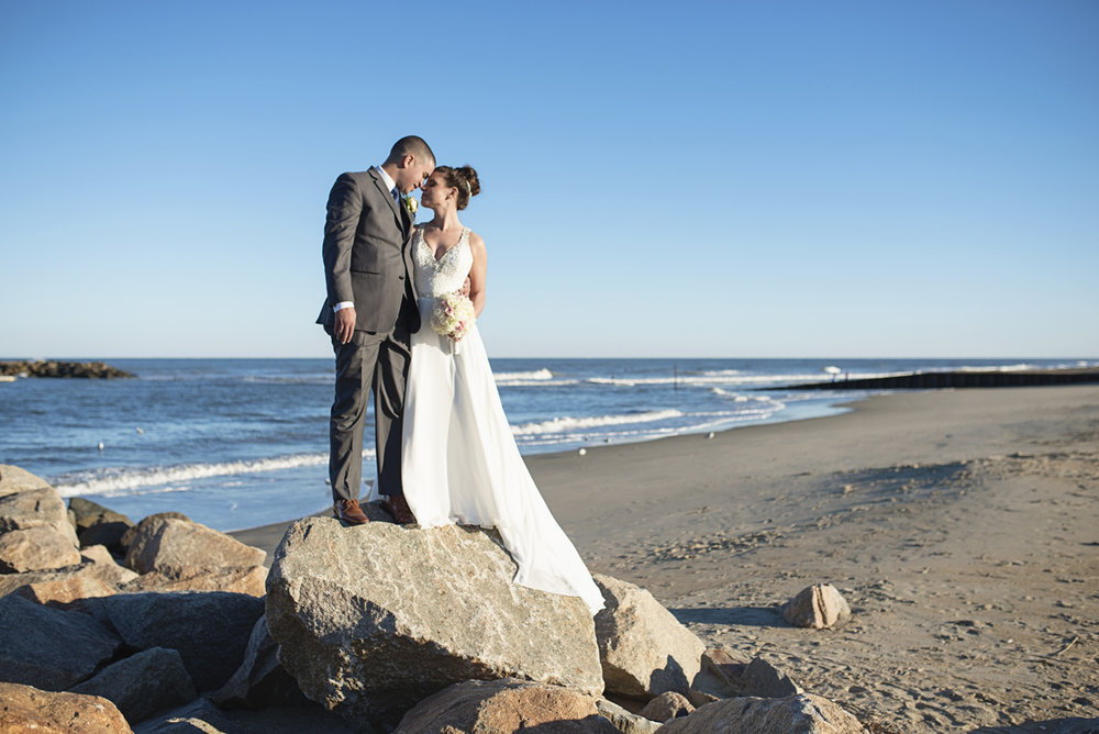 Blue and Silver Waterside Wedding | Virginia Beach Wedding | Adventurous rocky beach bride and groom portraits