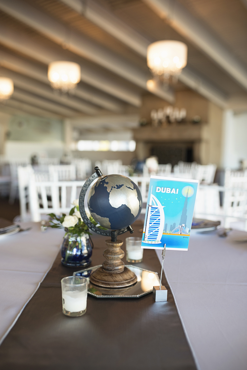 Blue and Silver Waterside Wedding | Virginia Beach Wedding | Worldwide travel themed reception centerpiece