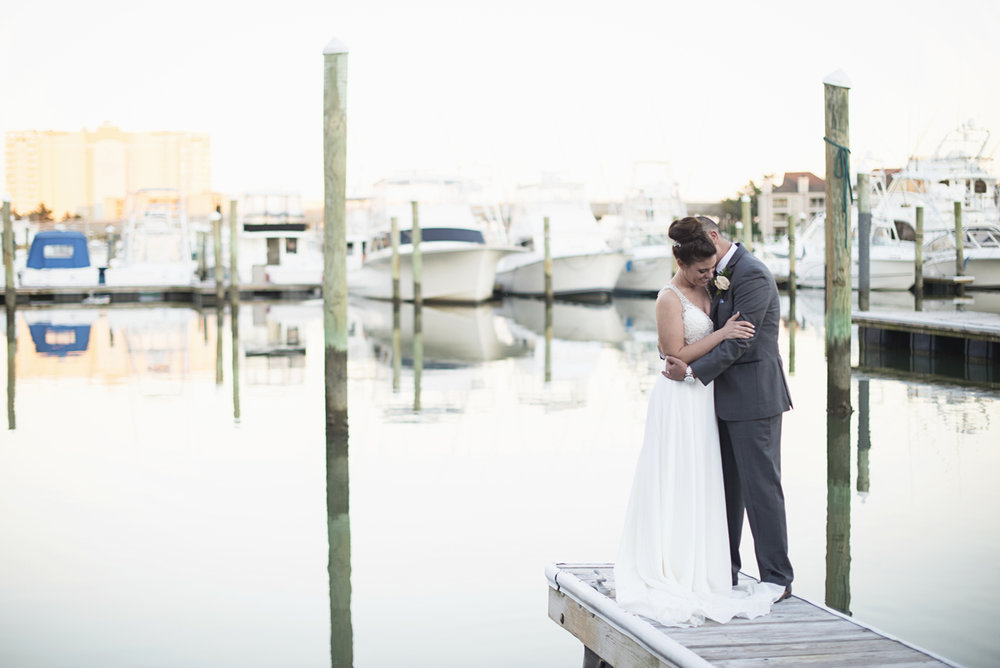 Blue and Silver Waterside Wedding | Virginia Beach Wedding | Sunset dockside bride and groom portraits