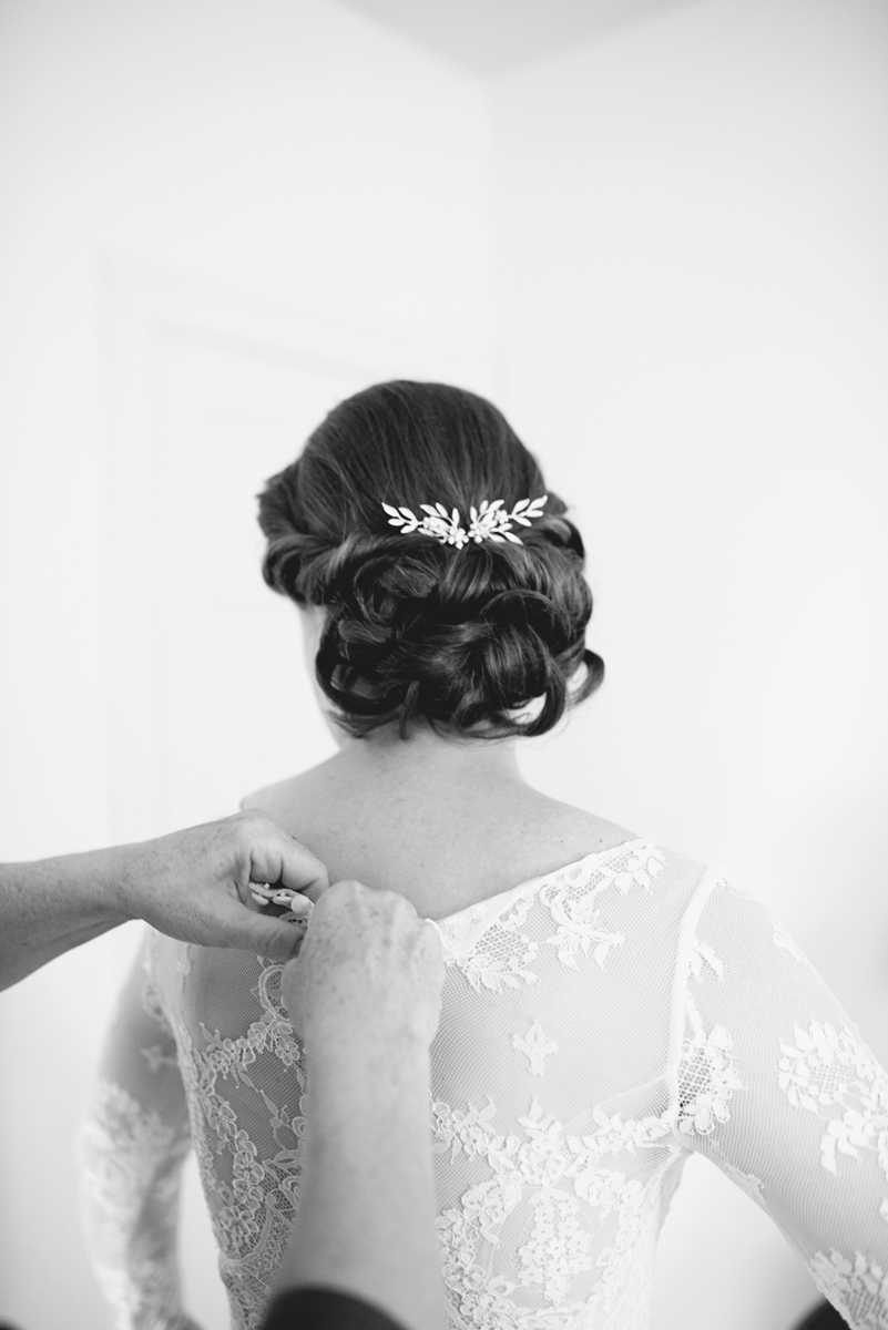 Bridal hair with leaf hairpiece and all-over lace wedding dress