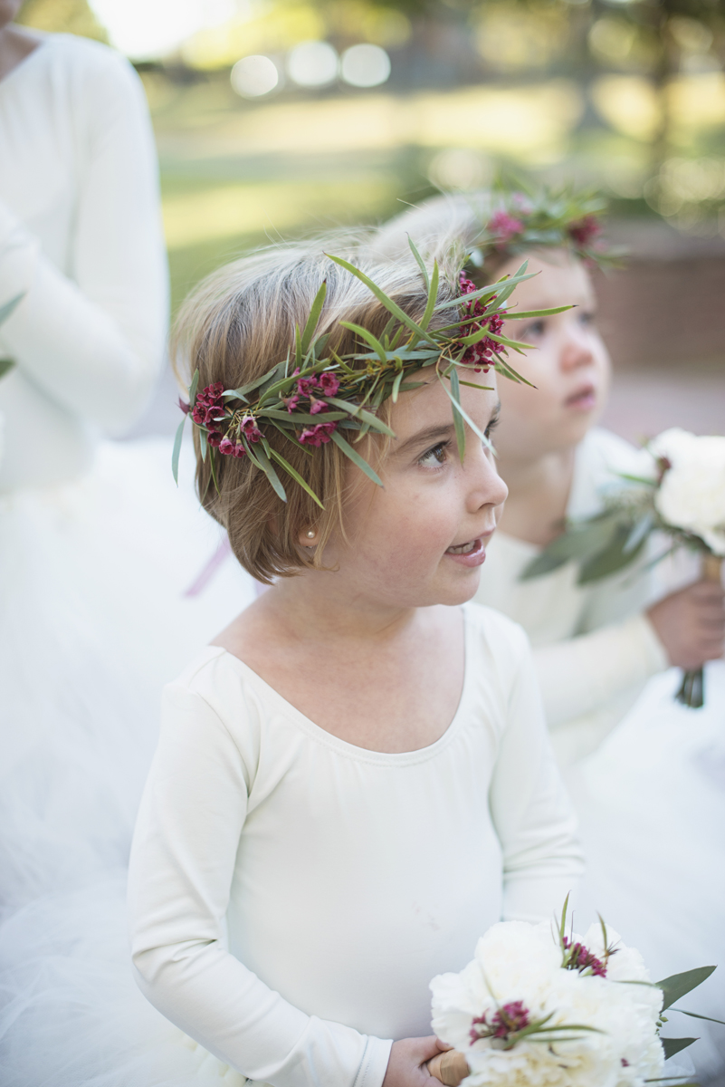 Flower girl in white tutu with crimson and green floral crown