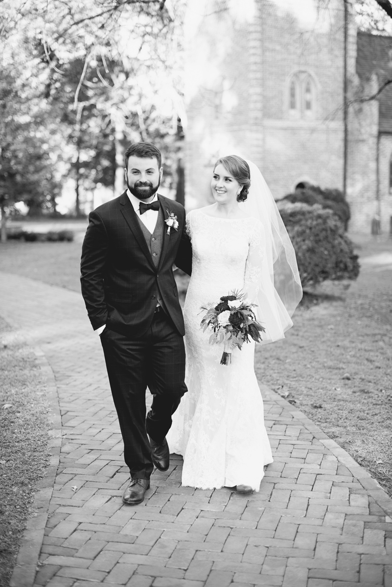 Iconic black and white bride and groom walking after their wedding