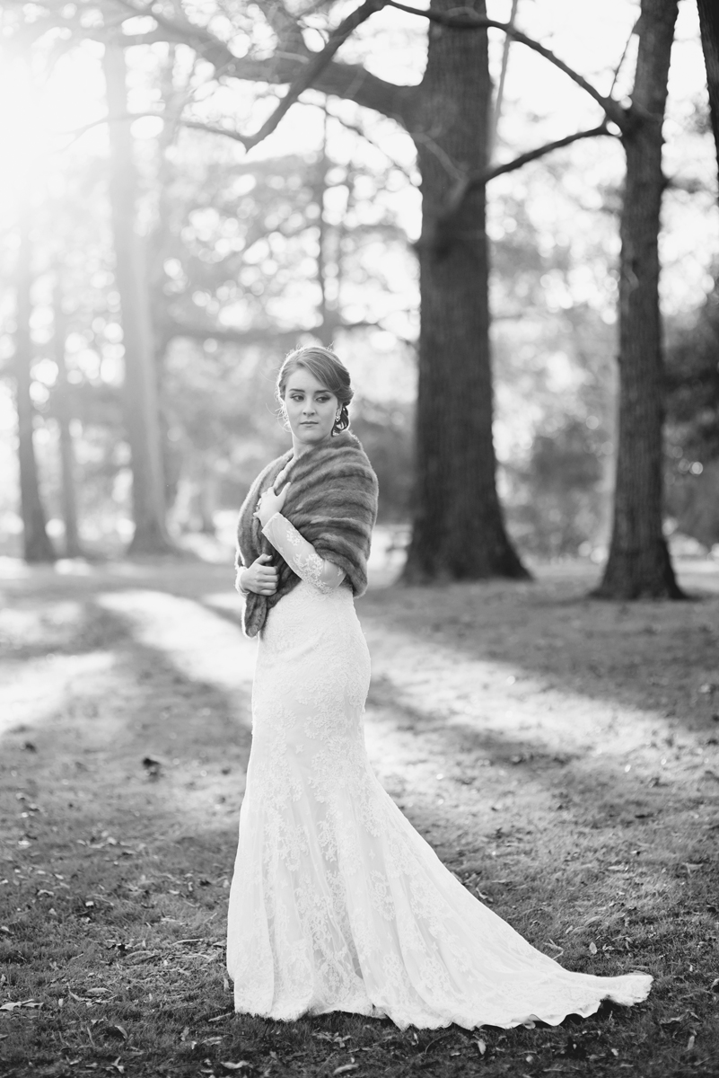 Bridal portraits with all-over lace long-sleeved wedding dress and mink shawl