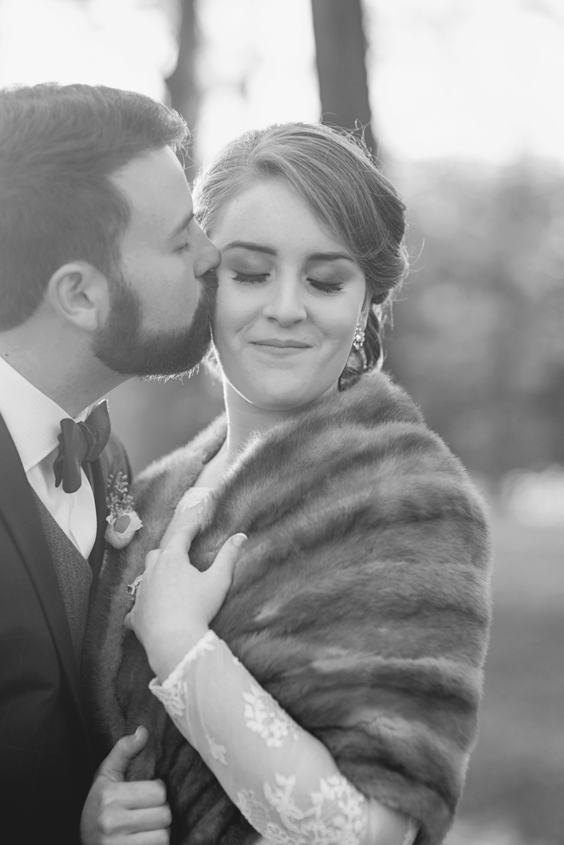 Bride and groom portraits with all-over lace long-sleeved wedding dress and mink shawl