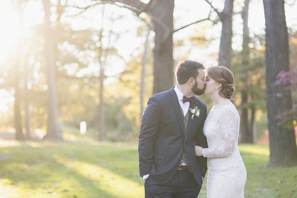 Bride and groom portraits with all-over lace long-sleeved wedding dress