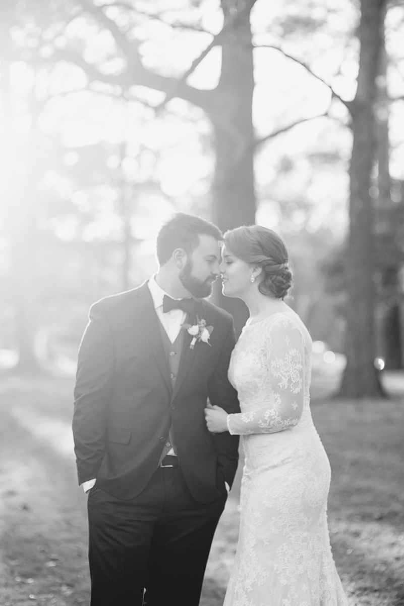 Bride and groom portraits with all-over lace long-sleeved wedding dress in black and white