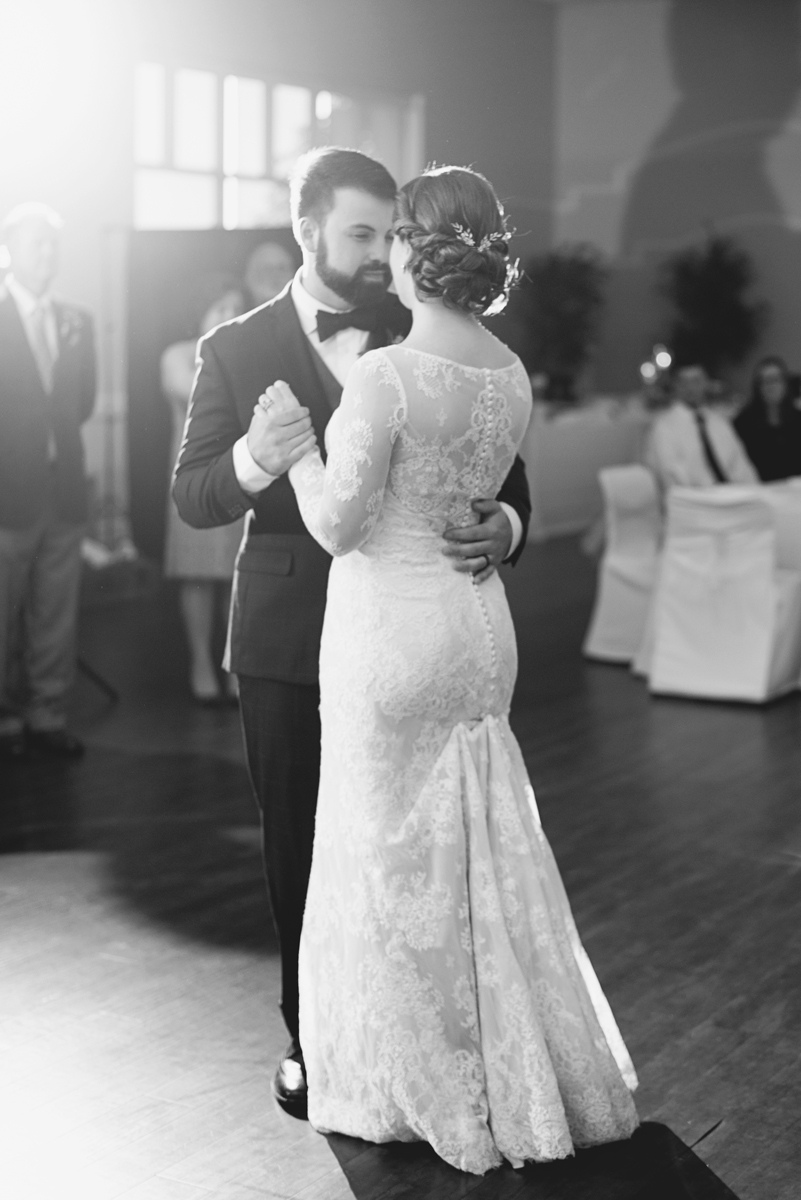 Iconic black and white bride and groom first dance at wedding reception