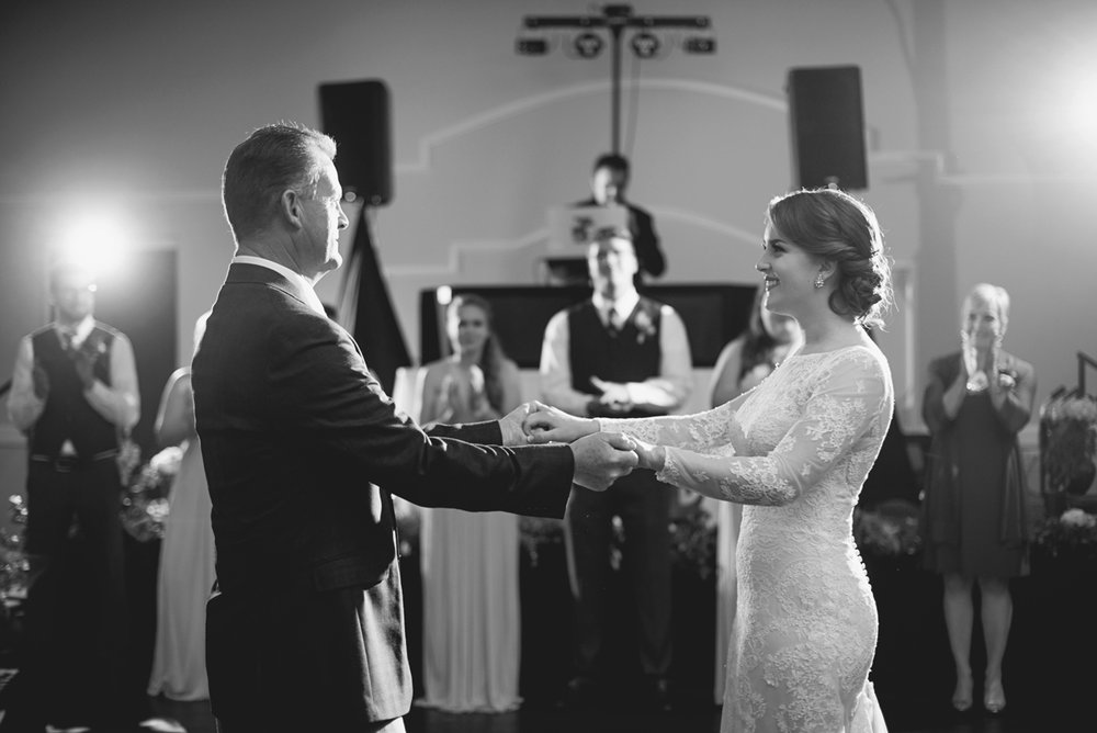 Father and daughter first dance at wedding in black and white