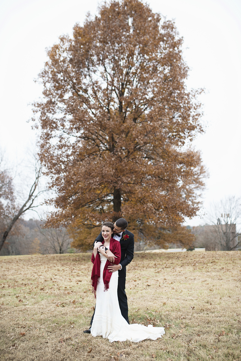 Downtown Nashville Winter Wedding | Crimson and Black Wedding | Bride and groom first look portraits