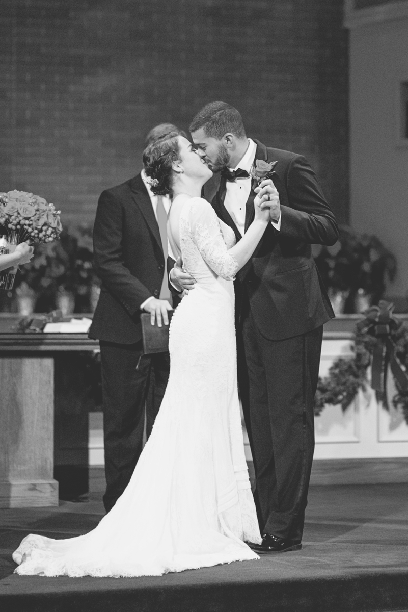 Downtown Nashville Winter Wedding | Crimson and Black Wedding | Bride an groom first kiss