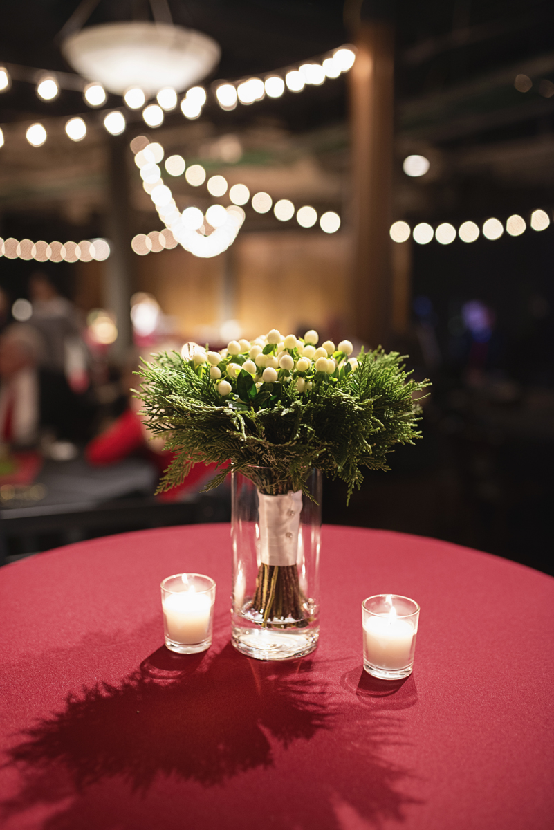 Downtown Nashville Winter Wedding | Crimson and Black Wedding | Green and white floral reception centerpiece