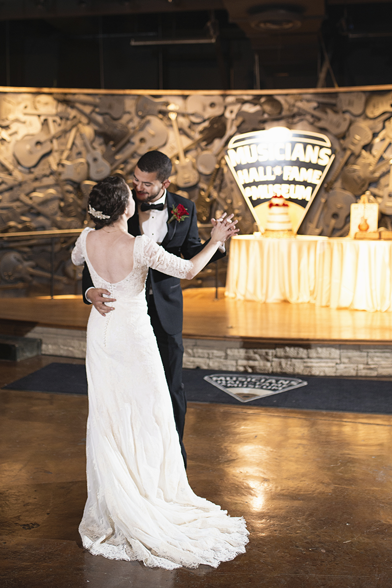 Downtown Nashville Winter Wedding | Crimson and Black Wedding | Bride and groom first dance