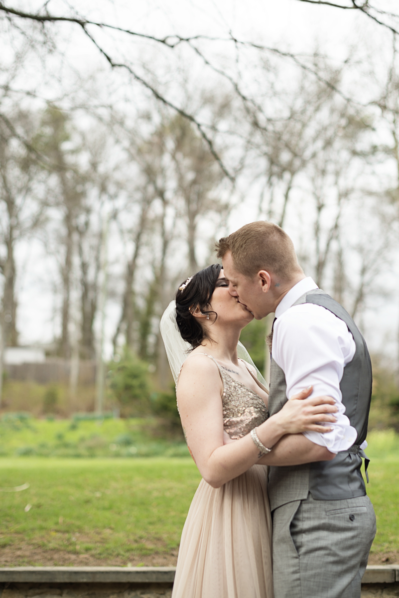 Blush and Gray Spring Wedding | Maryland Wedding | Bride and groom first kiss