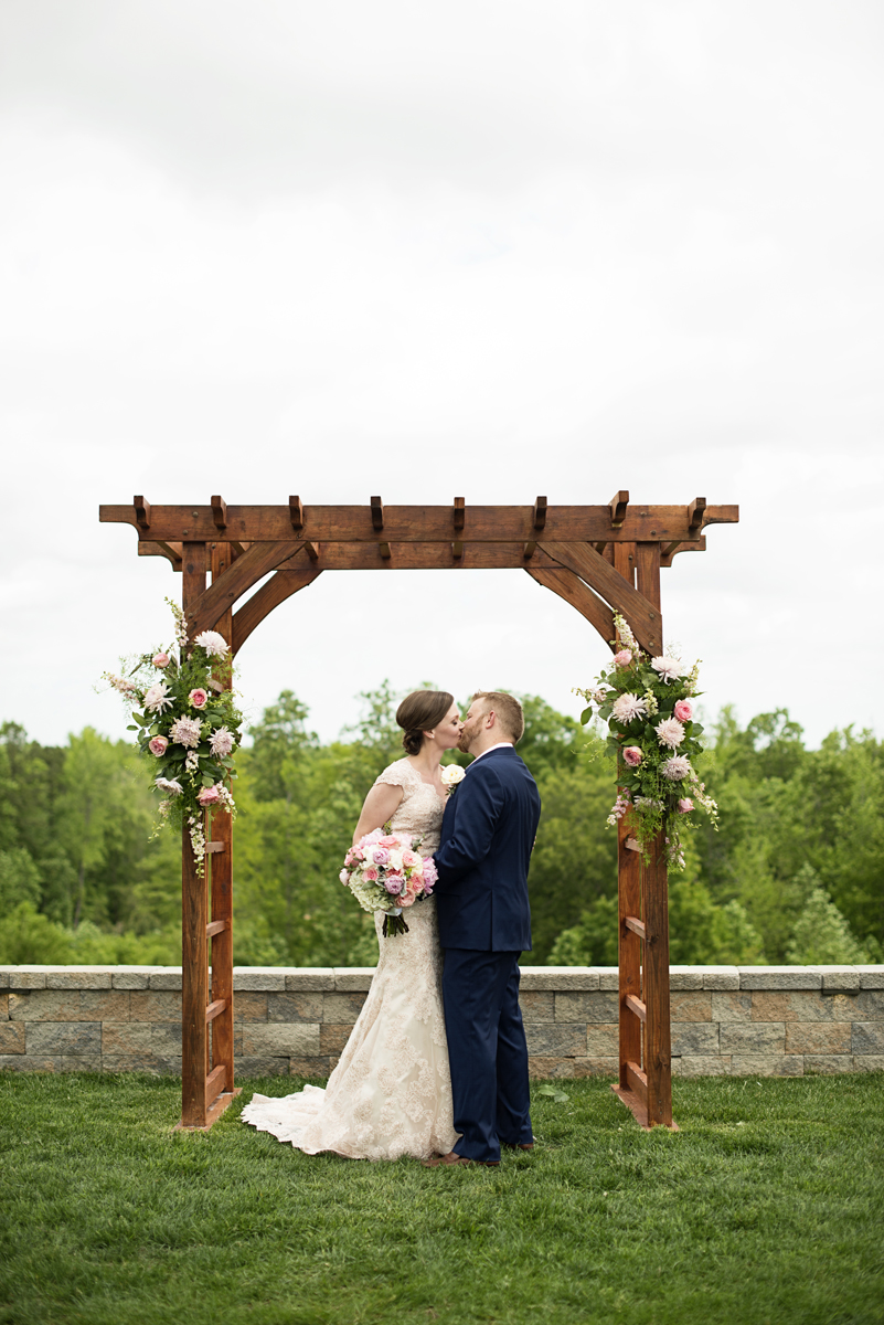 Elegant Summer Winery Elopement | Bride + Groom First Kiss