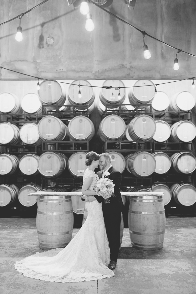 Elegant Summer Winery Elopement | Bride + Groom Wine Cellar Portrait