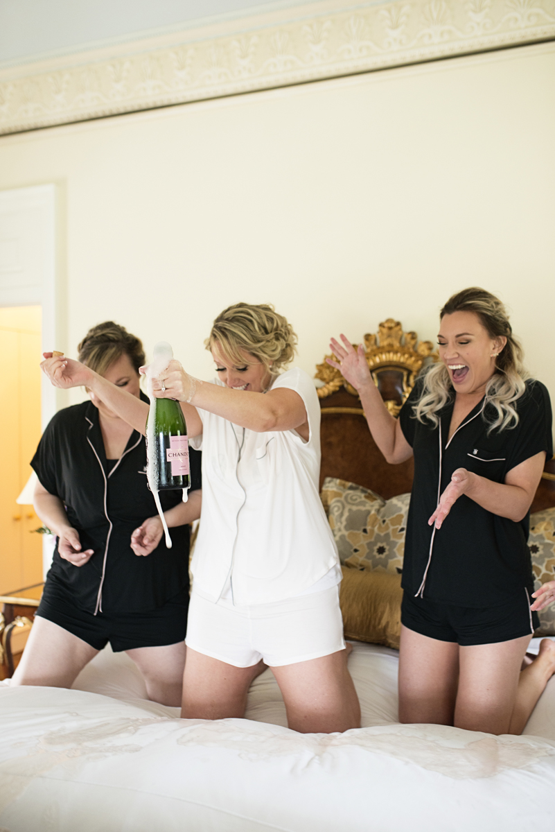 Albemarle Estate at Trump Winery Wedding | Bride Popping Champagne