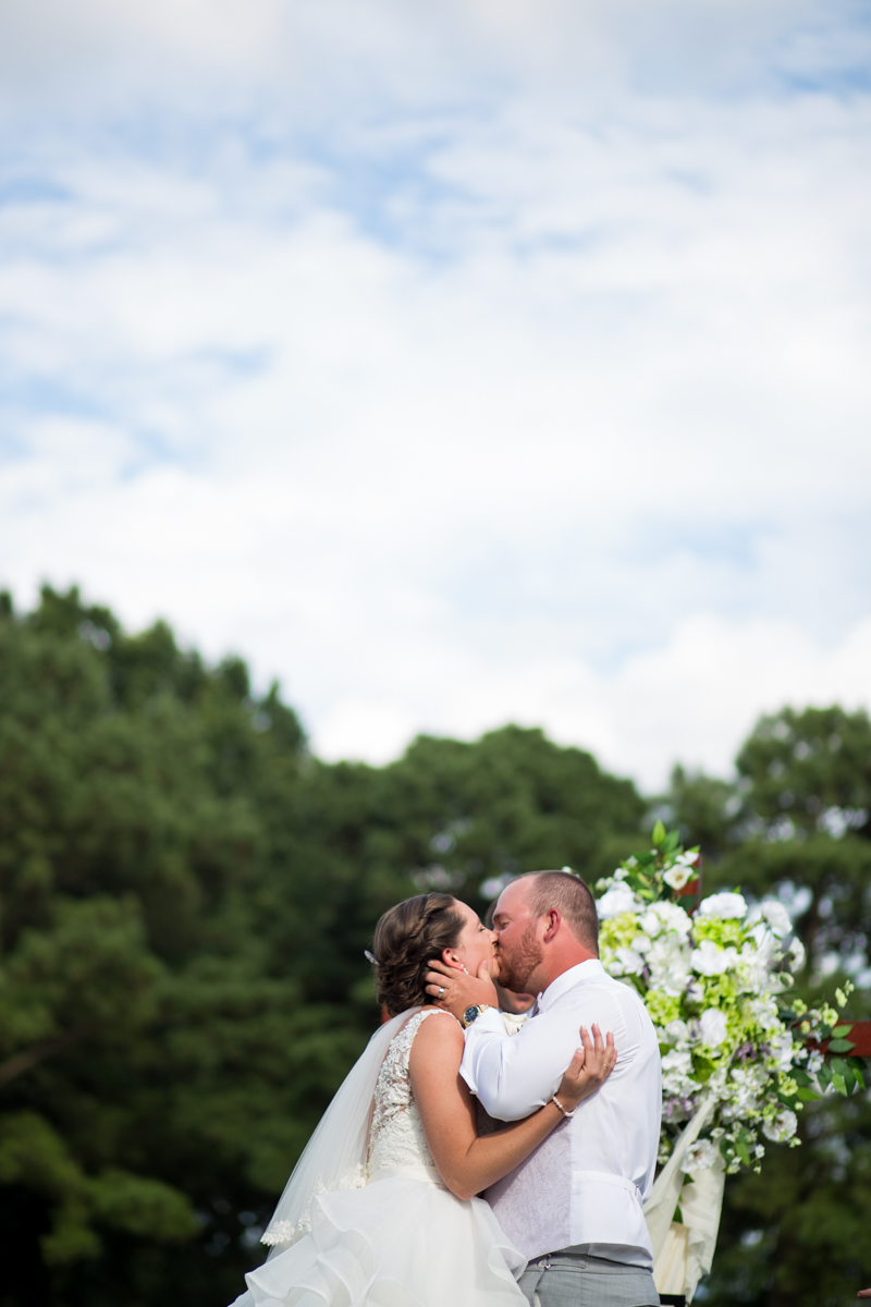 Lavender and Pale Green Virginia Beach Wedding | Bride and Groom First Kiss