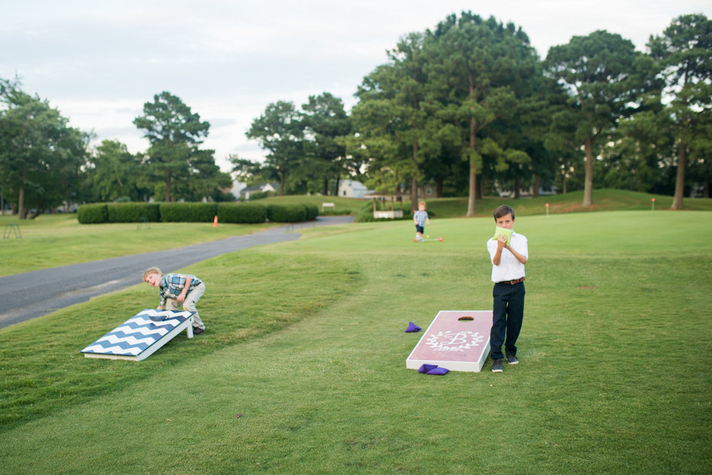 Lavender and Pale Green Virginia Beach Wedding | Wedding day cornhole