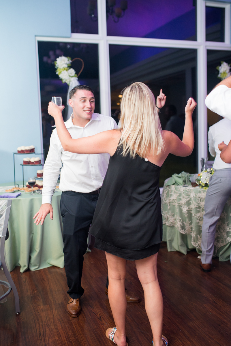 Lavender and Pale Green Virginia Beach Wedding | Wedding reception guests dancing